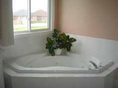 Enjoy a soak in the ensuite whirlpool after a hard day at work
